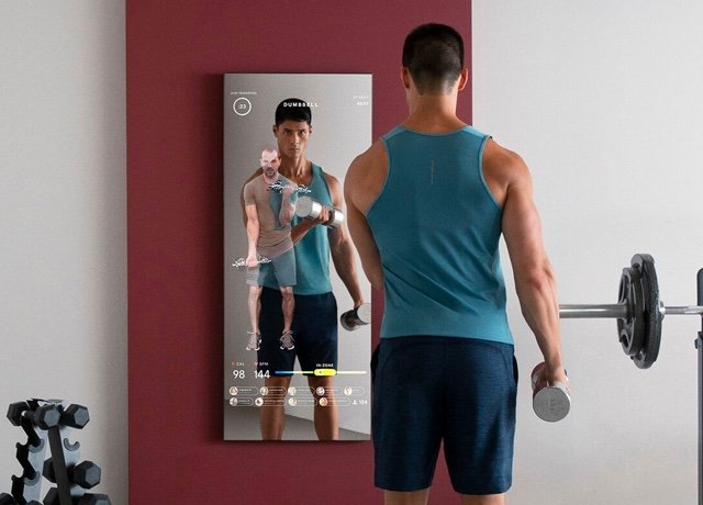 a man works out with the MIRROR