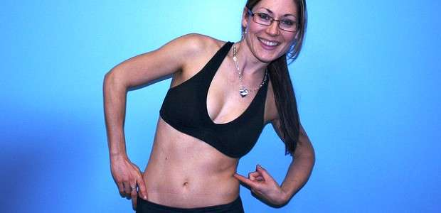 a woman shows off her abs