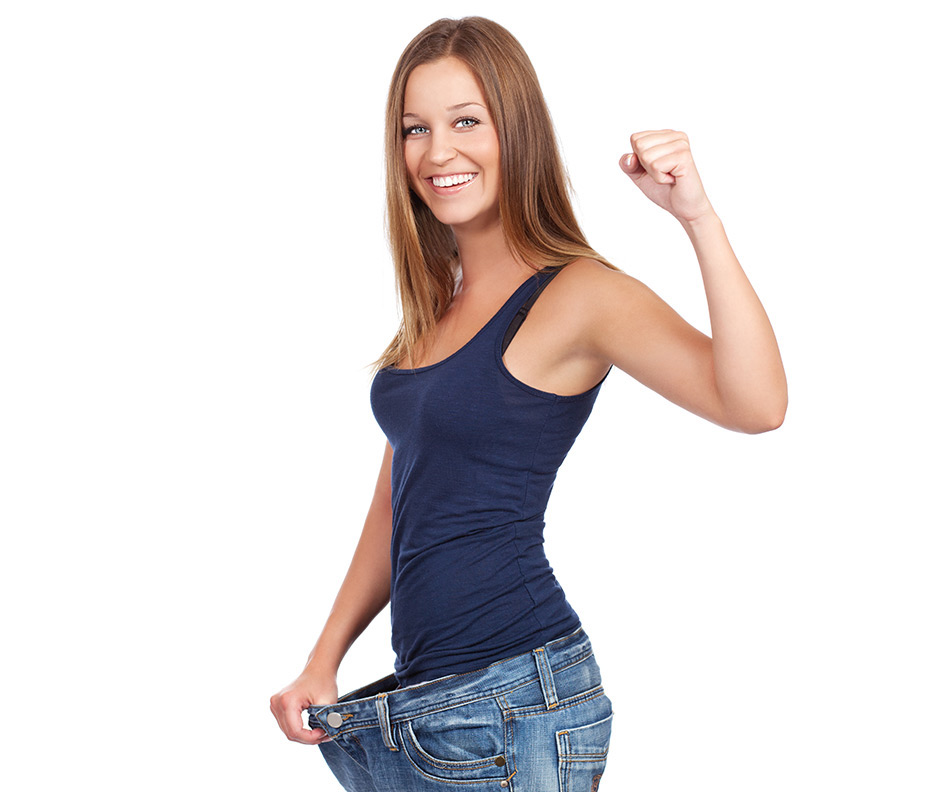 a woman flexes after losing weight