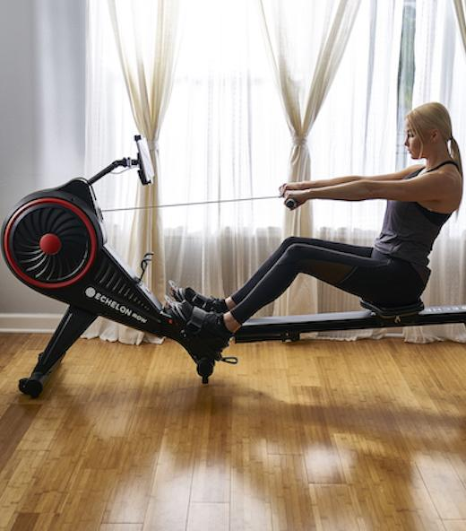 a woman uses her Echelon Smart Rower